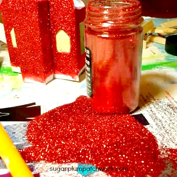red glitter in bottle and on putz house