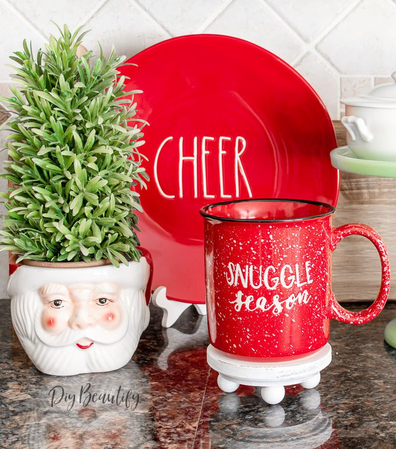 red Christmas display with white farmhouse riser