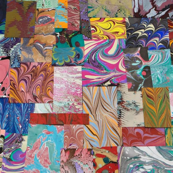 small squares and rectangles of colorful marbled papers
