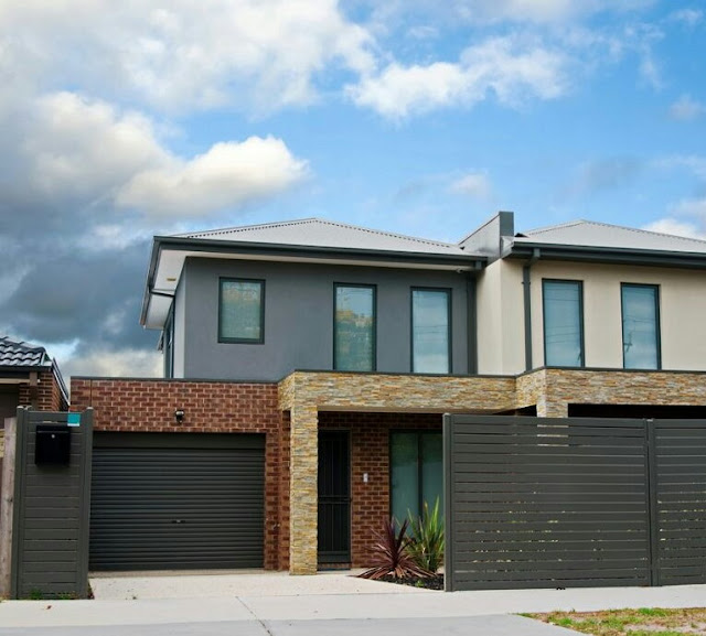 2-storey house design with natural stone