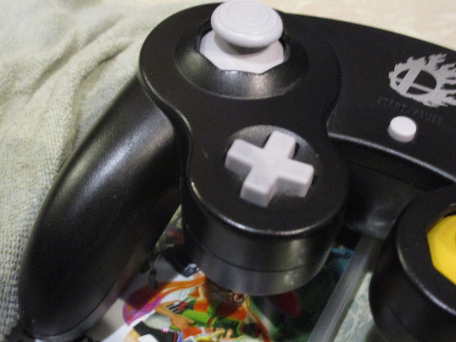 Dirty grimy sweat black Smash Bros Nintendo GameCube controller wash cloth