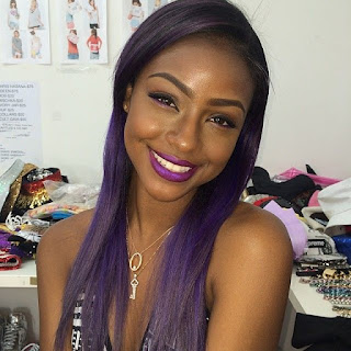 black woman with purple hair