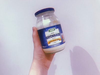 my left hand holding a jar of mayonnaise