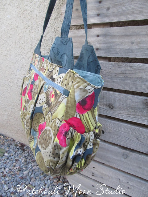 Side view of the yoga bag showing the elastic pockets that hold a water bottle or spray bottle.