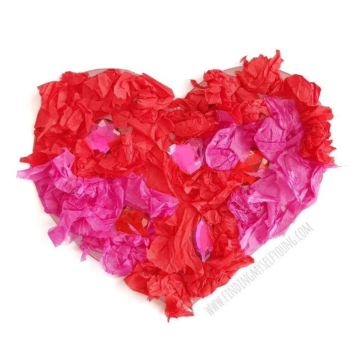tissue paper heart on contact paper