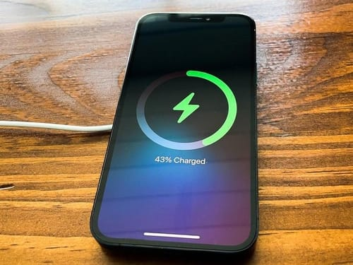 How do I change the charging method of iPhone smartphones to reduce battery drain?