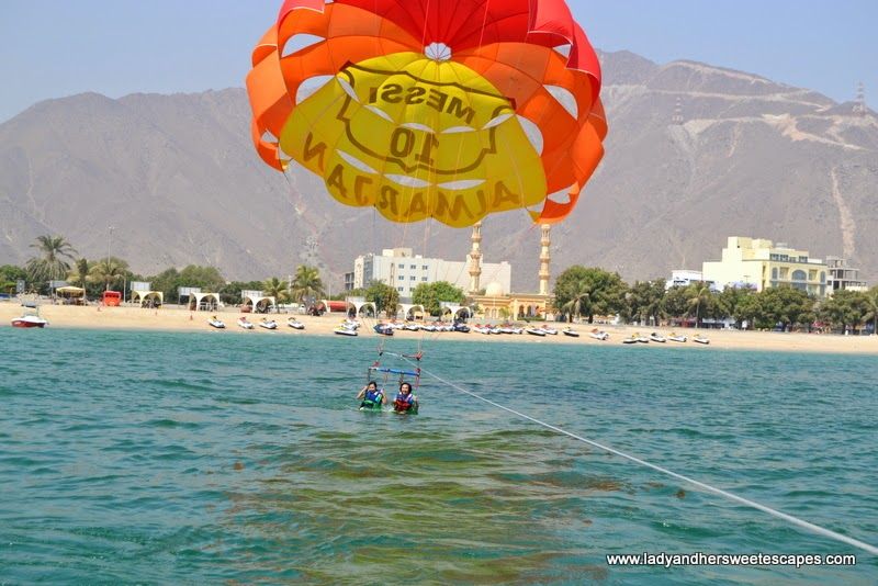 refreshing dip while parasailing in Khorfakkan