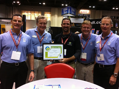PADI Green Star Award presented to Stuart Gow of Matava by Drew Richardson, President of PADI at DEMA 2012