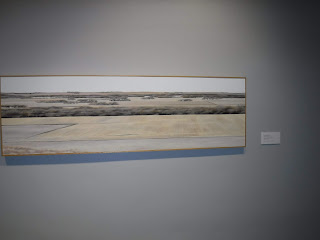 a digitally printed canvas art piece at the Sioux City Art Center depicts golden fields and green trees typical of an Iowa landscape