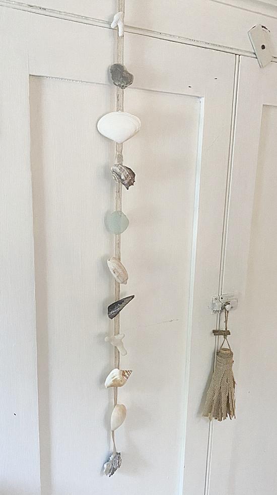 shell garland hanging on hutch