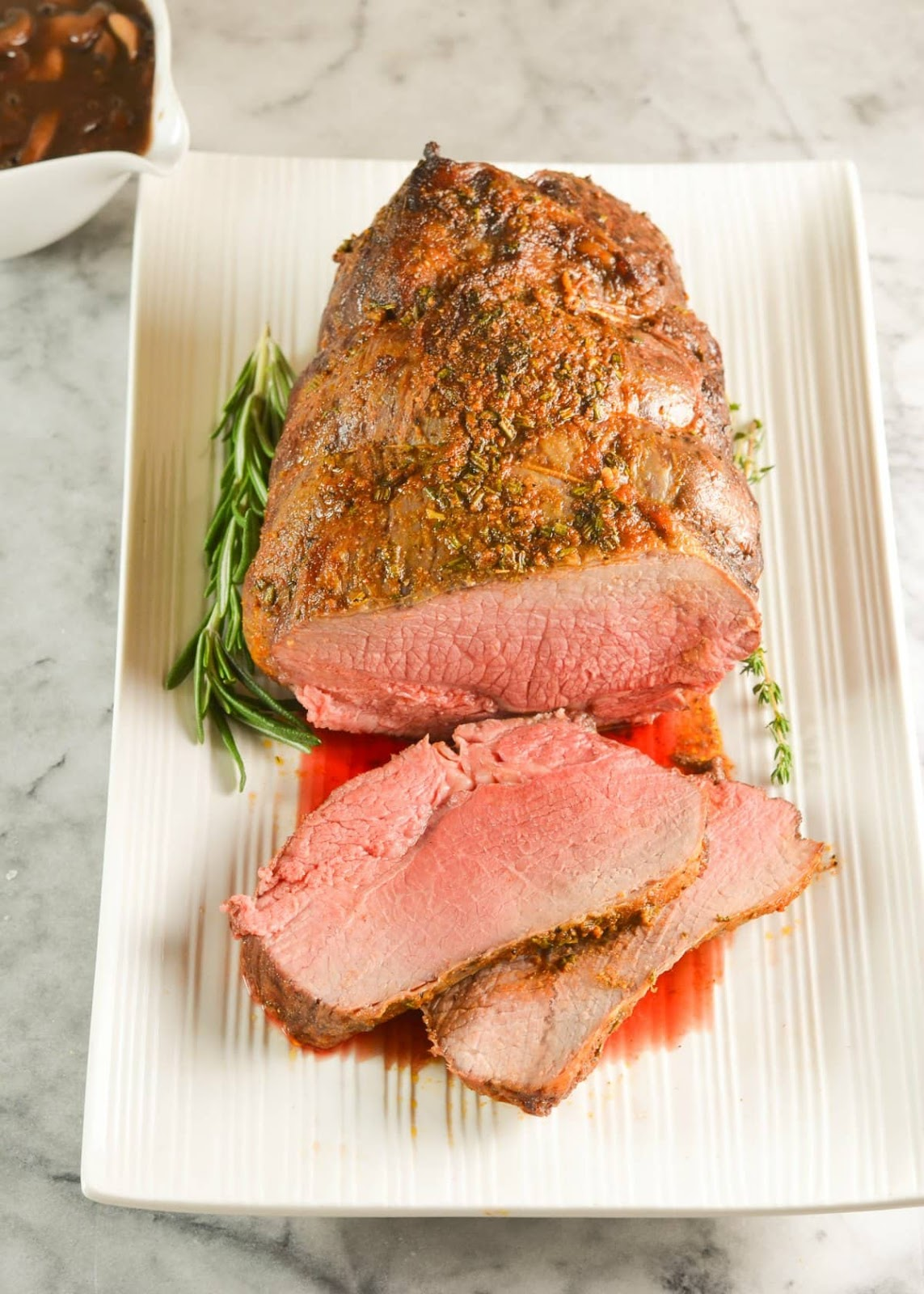 Sirloin Roast Beef with Mushroom Red Wine Gravy is a favorite Sunday Roast. So much flavor from herb butter and the hearty gravy. Delicious for Thanksgiving or Christmas from Serena Bakes Simply From Scratch.