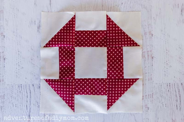 red and white churn dash quilt block