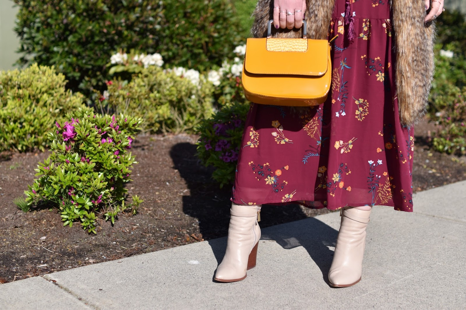 Monika Faulkner outfit inspiration - maroon floral maxi dress, long faux-fur vest, Vince Camuto booties, patent yellow mini bag