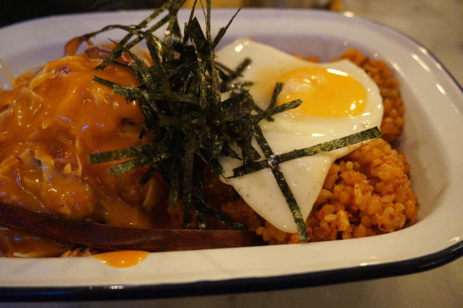 Korean style kimchi bacon paella with a perfectly cooked fried egg on top