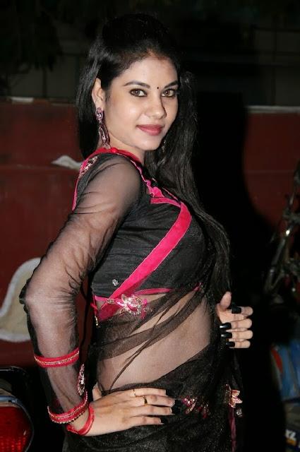 Nivisha South Actress Hot Stills in Half Black Transparent Saree Exposing Actress Trend