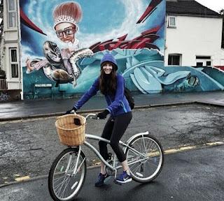 Mallory Jansen on bicycle
