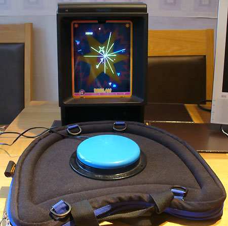 One-switch adapted Vectrex running Minestorm, on a Trabasack.