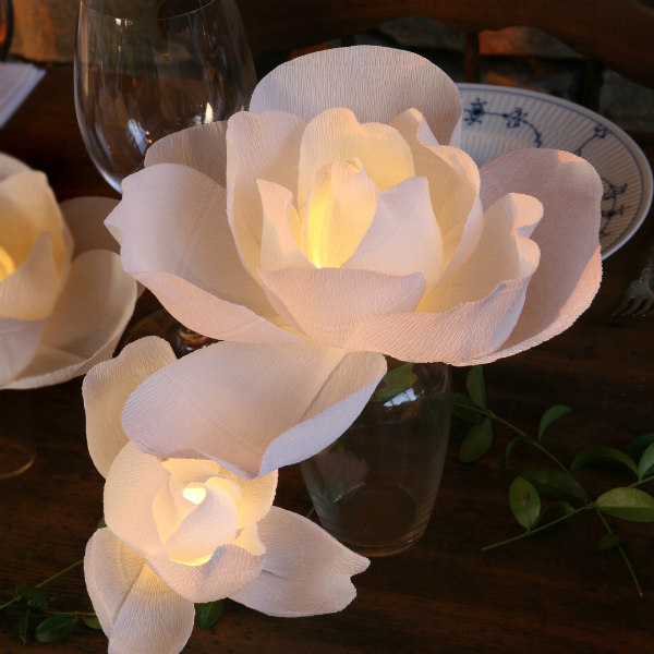 white paper lighted magnolia centerpiece