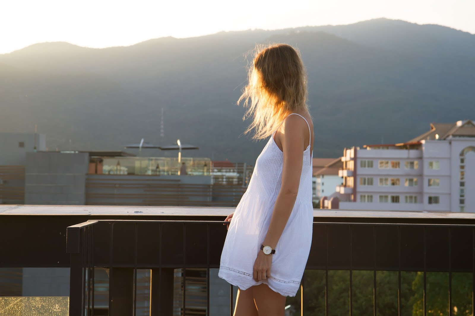 Fashion and travel blogger, Alison Hutchinson, taking in the view of the sunset in Chiang Mai Thailand