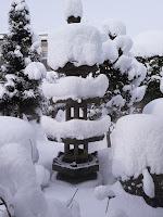 Pagoda-like garden lantern covered in snow in Yamagata