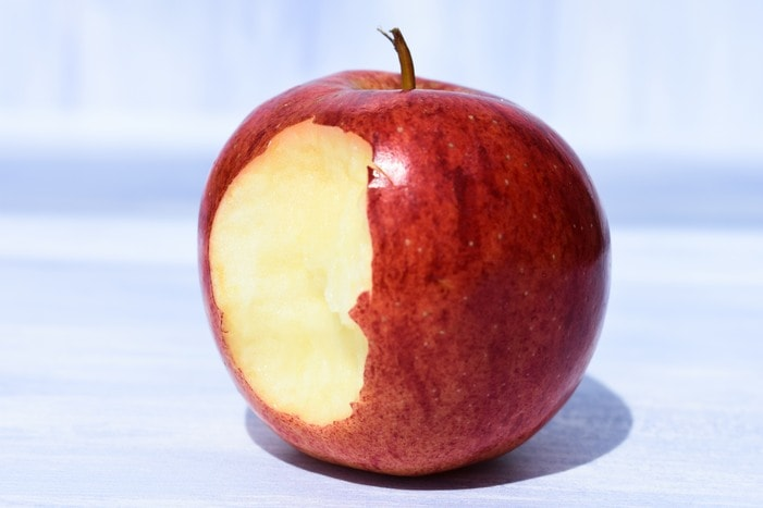 red apple with bite out of it