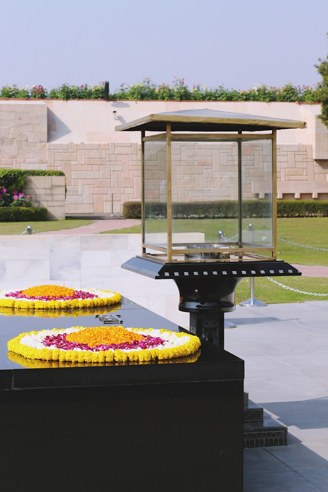 The black marble platform of Raj Ghat- Gandhi's tomb- with bright flowers on top