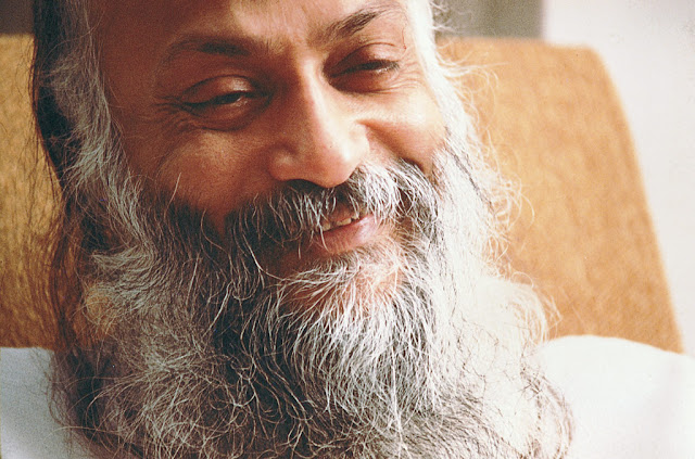 Aspiration-of-Virat-meets-and-is-holding-loud-petals-Osho