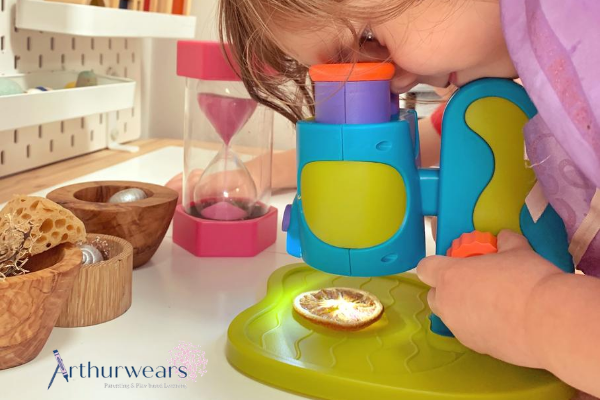Child looking through Learning Resources first microscope
