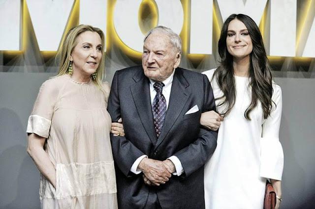 Rockefeller com duas mulheres