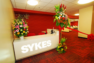 Front desk of SYKES Asia Inc., in Glorietta 1 Makati City Philippines