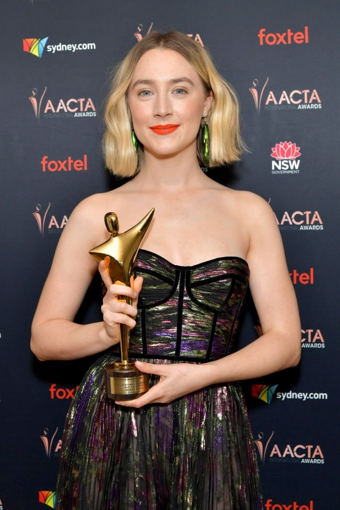 Saoirse Ronan poses with her Best Actress award at the 9th Annual Australian Academy of Cinema and Television Arts (AACTA) International Awards