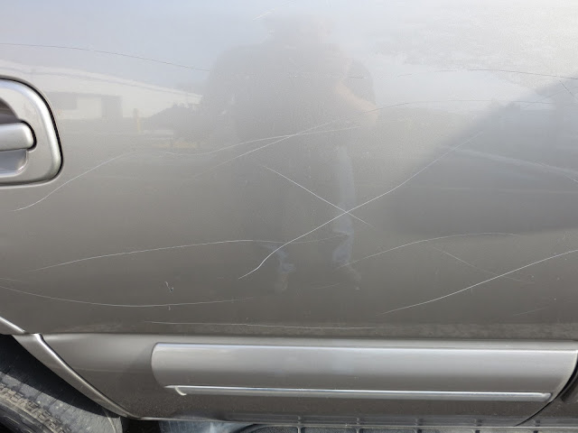 Key scratches on 2001 Chevy Tahoe before repairs & paint at Almost Everything Auto Body