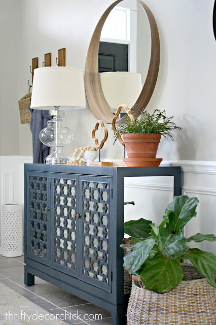 Round mirror over console table