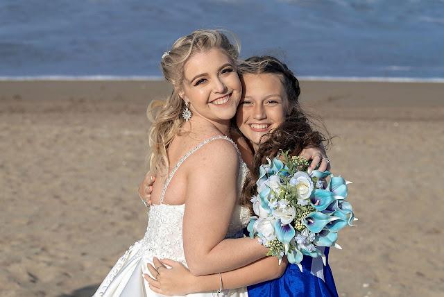 Bride hugging Bridesmaid on the beach
