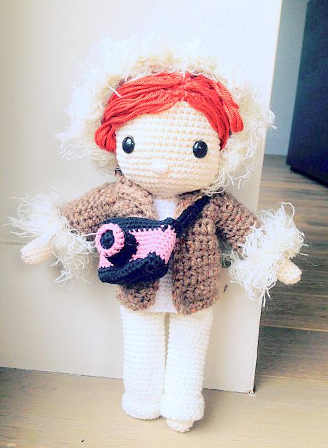 Crochet pattern amigurumi doll girl in winter coat and photo camera