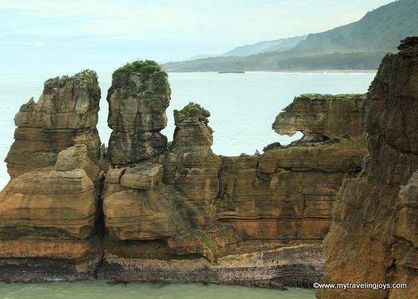 What the heck are pancake rocks in new zealand my traveling joys do you see the different facesshapes in these rocks you cant miss the wombat or crouching tiger looking rock on the right side ccuart Image collections