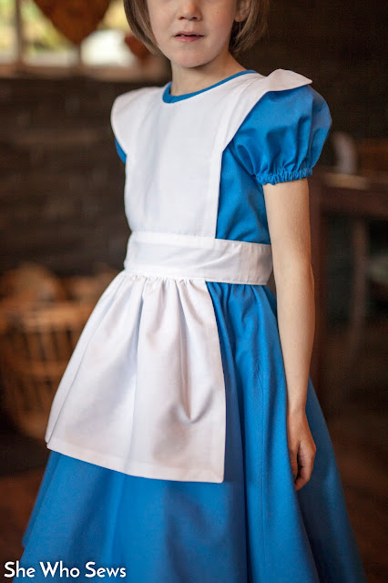 White apron over blue dress