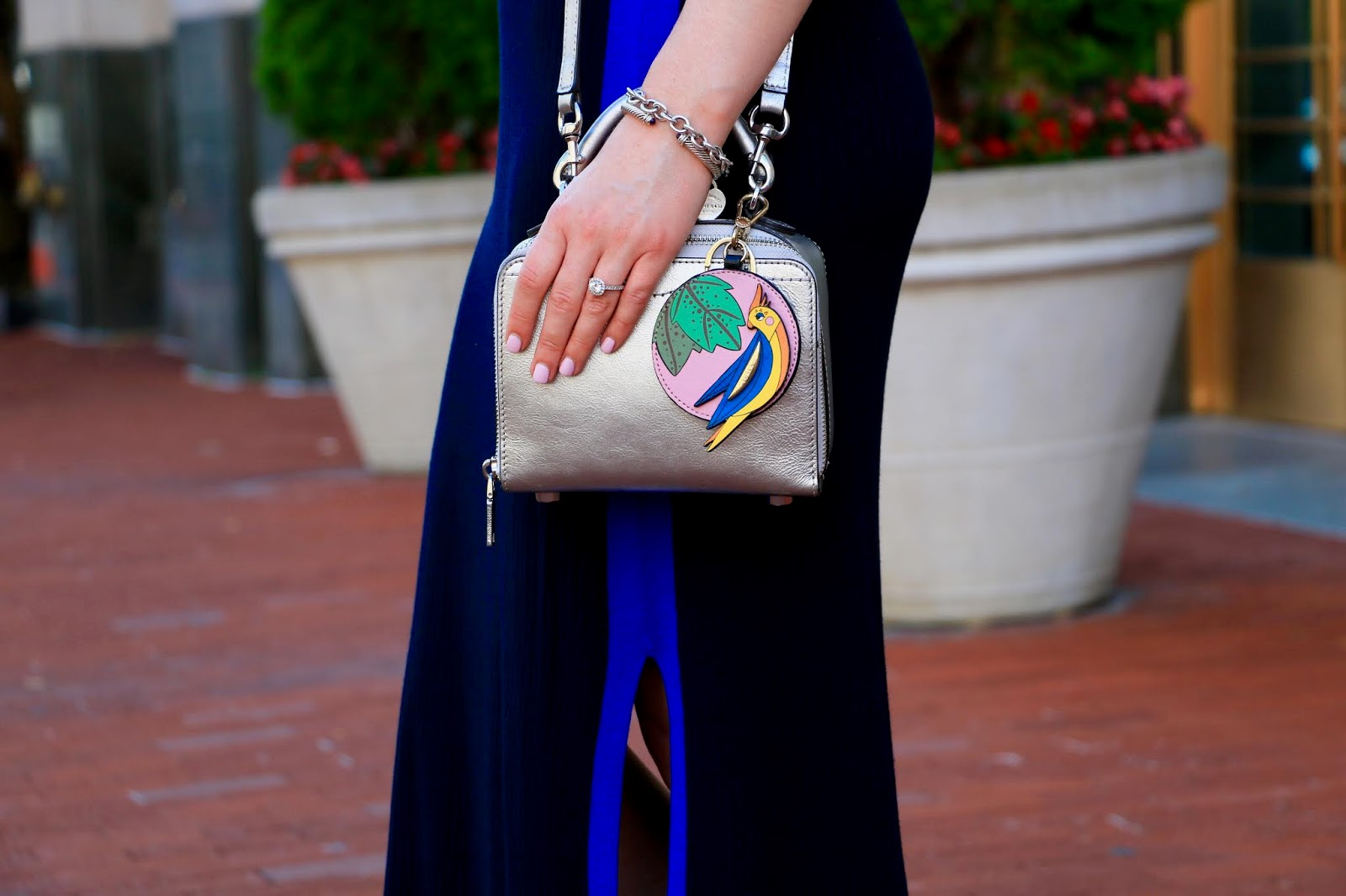 Nyc fashion blogger Kathleen Harper wearing a silver Rebecca Minkoff purse.