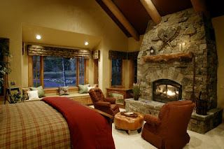 Interesting Bedroom Details with Stone Rustic Fireplace Mantels and some Brown Sofas near the Wooden Bed