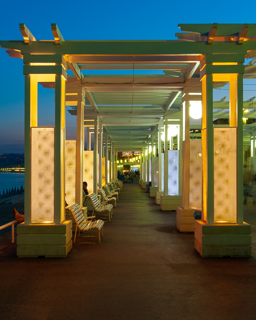 a photo of the boardwalk at dusk in nice france