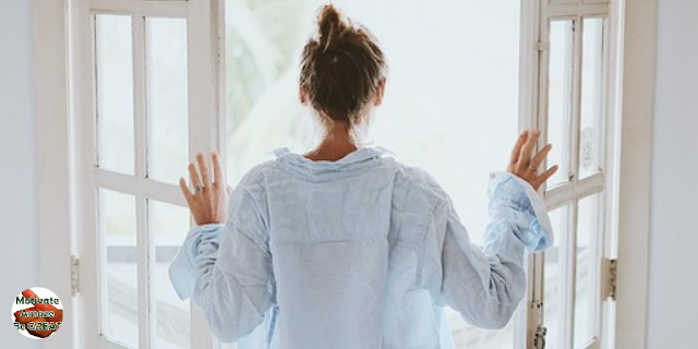 "Featured in the article: ""How To Motivate Yourself Daily In 3 Effective Ways"". Represents a motivated woman waking up, starting her daily routine."