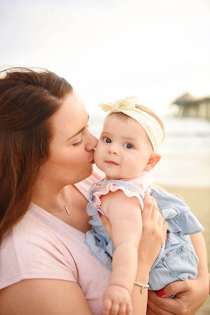 mom kissing baby on cheek , family beach pictures