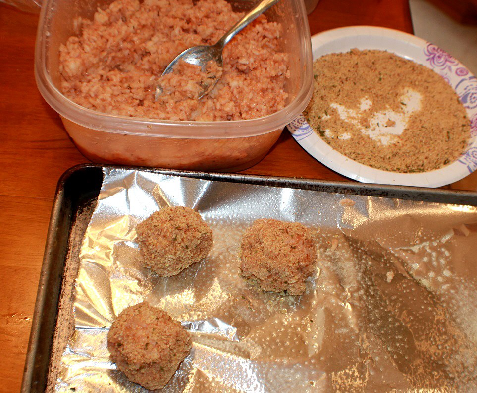 This is the mixture for making rice balls and shaping them into balls on an oil sprayed cookie sheet