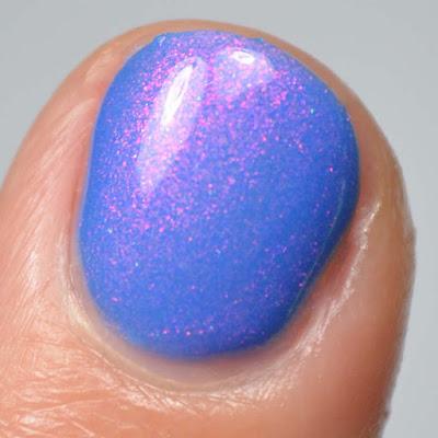 neon blue nail polish with color shifting shimmer