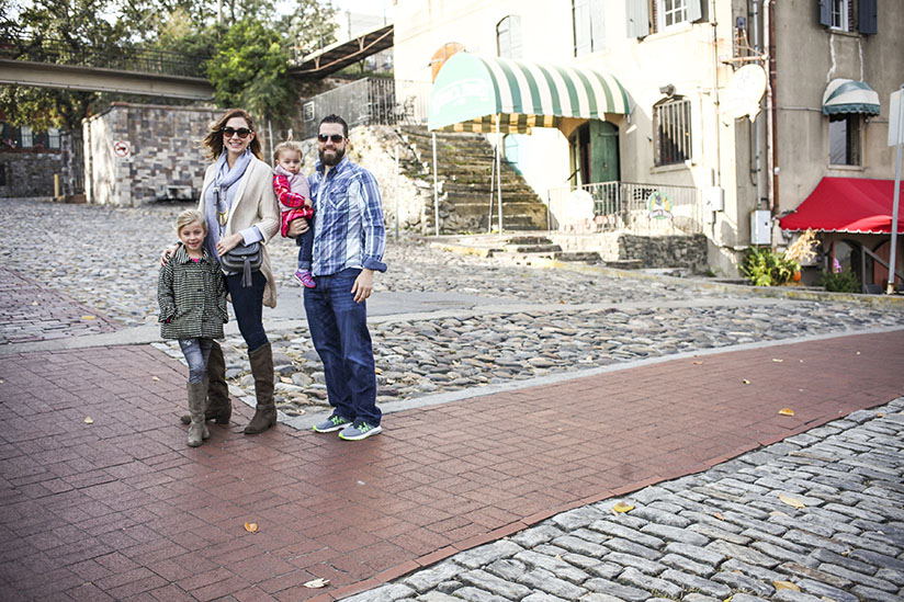 Amy West and family pose on River St in Savannah.