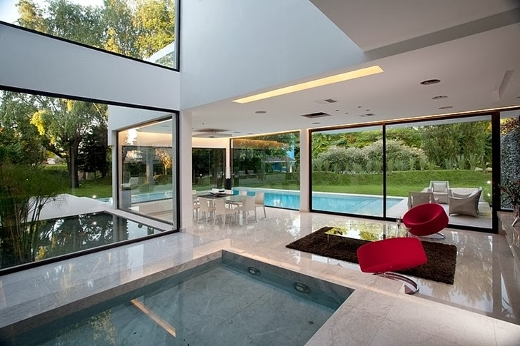 Interior pool in Minimalist Casa Carrara by Andres Remy Architects
