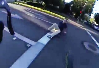 Angry driver gets laid out for attacking cyclist waiting for pedestrians to cross