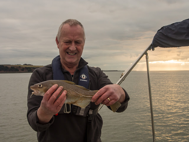 Photo of Phil with the first cod he has caught from Ravensdale