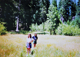 Piper and Jamie hiking through the meadow
