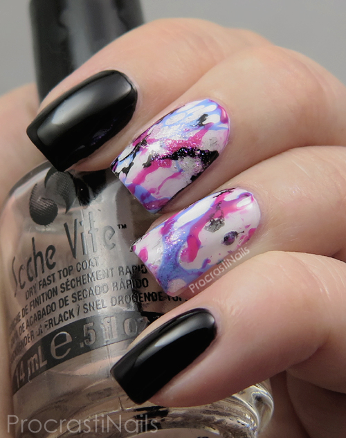 Water spotted nail art with pink, blue, black and white nail polish